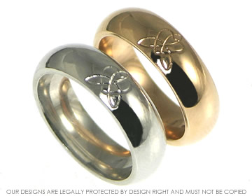 a pair of 9ct rose and white gold celtic hand engraved commitment rings