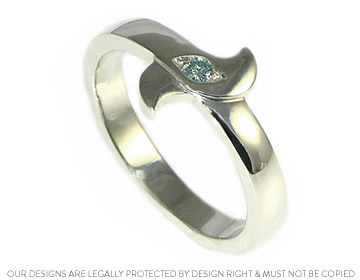 9ct white gold with a heat treated ice blue diamond