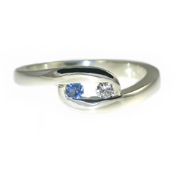 twist style engagement ring with a diamond and sapphire