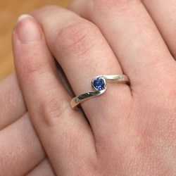 9ct white gold, sapphire and diamond swirl engagement ring