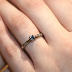 fairtrade and fairmined white gold ring with a grey spinel and 0.068ct diamond