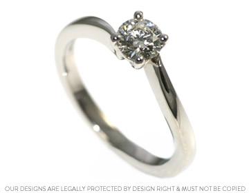 a unique platinum and diamond solitaire twist engagement ring