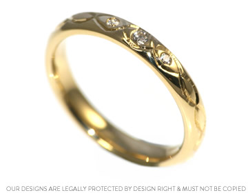 celtic knot inspired yellow gold and wedding ring