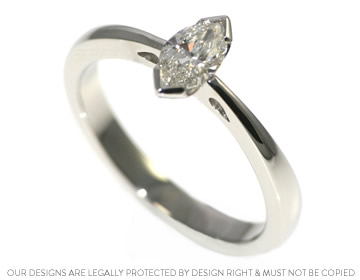 0.45ct h si marquise cut diamond and platinum engagement ring