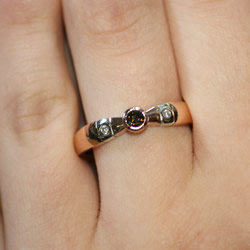 9ct rose and white gold engagement ring holding a chocolate diamond