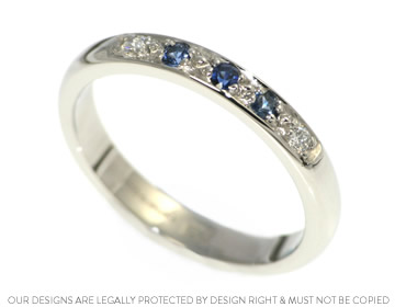 delicate sapphire and diamond platinum eternity ring