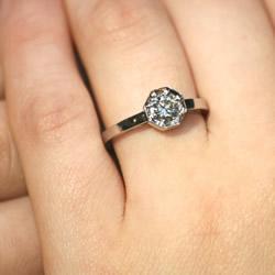 a beautifully unique art deco diamond solitaire engagement ring