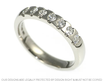 stunning 0.60ct diamond and palladium eternity ring