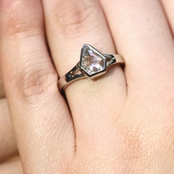 a beautiful platinum and recycled diamond engagement ring