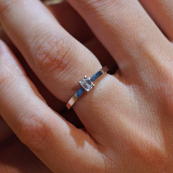 a delicate art deco inspired palladium and diamond engagement ring