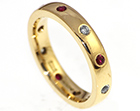 gleyns yellow gold ruby and green sapphire ring