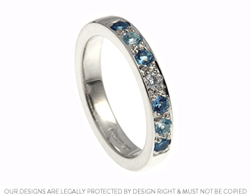 striking diamond, topaz and aquamarine 9ct white gold eternity ring