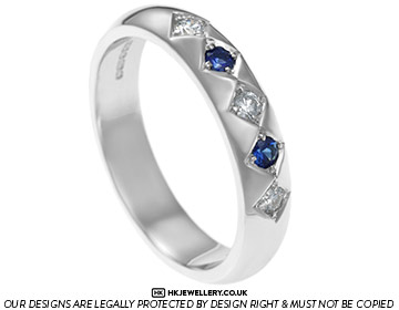 striking diamond and sapphire 9ct white gold eternity ring