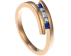 9ct rose gold engagement ring with graduating blue sapphires