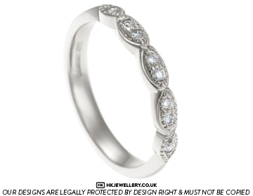 unique diamond half eternity ring with marquise shaping
