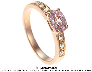 rare 0.96ct peach sapphire diamond and 18ct rose gold engagement ring