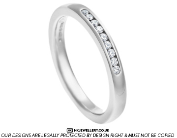 delicate platinum and diamond channel set eternity ring