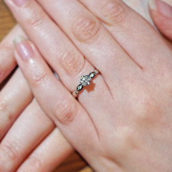 delicate floral inspired palladium and diamond engagement ring