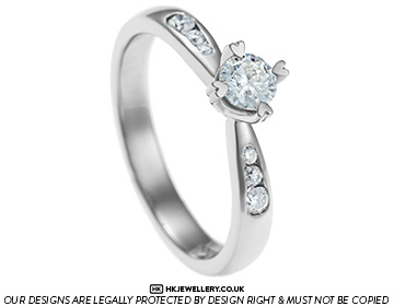 palladium and diamond engagement ring with heart detailing