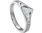 striking 0.34ct trilliant cut diamond and palladium engagement ring