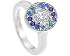 0.61ct oval diamond, graduated sapphire and aquamarine engagement ring