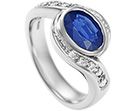 twist style 1.44ct sapphire and pave set diamond engagement ring