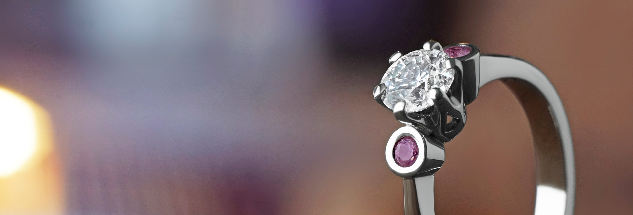 0.54ct H SI diamond and pink sapphire platinum engagement ring