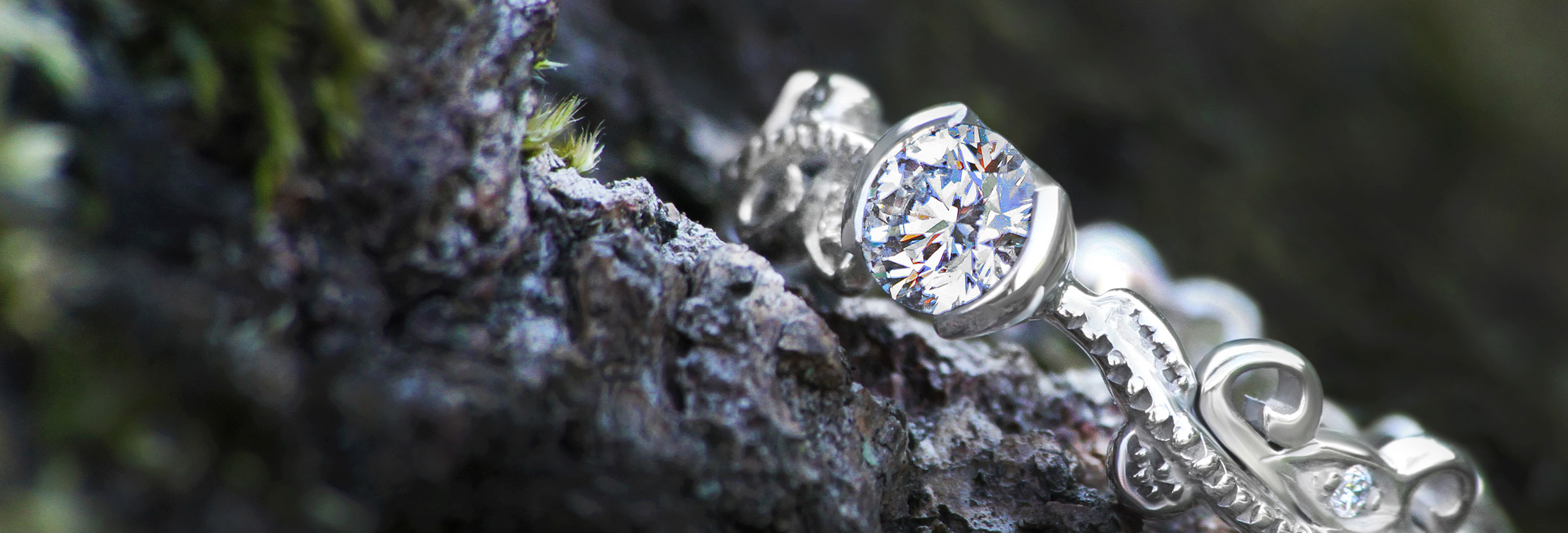 Vine inspired engagement ring with a stunning diamond