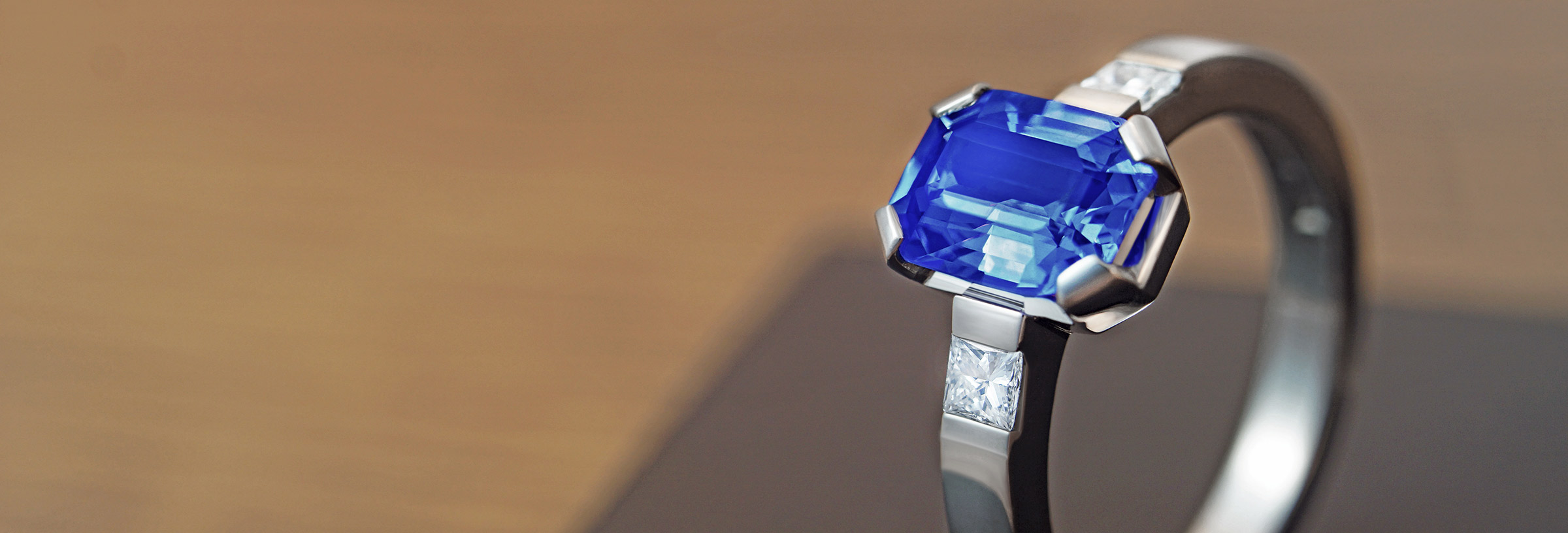 Stunning emerald cut blue sapphire and palladium engagement ring