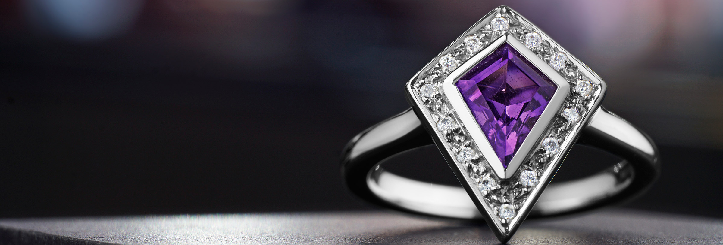 Kite shaped 0.72ct amethyst, diamond and palladium ring