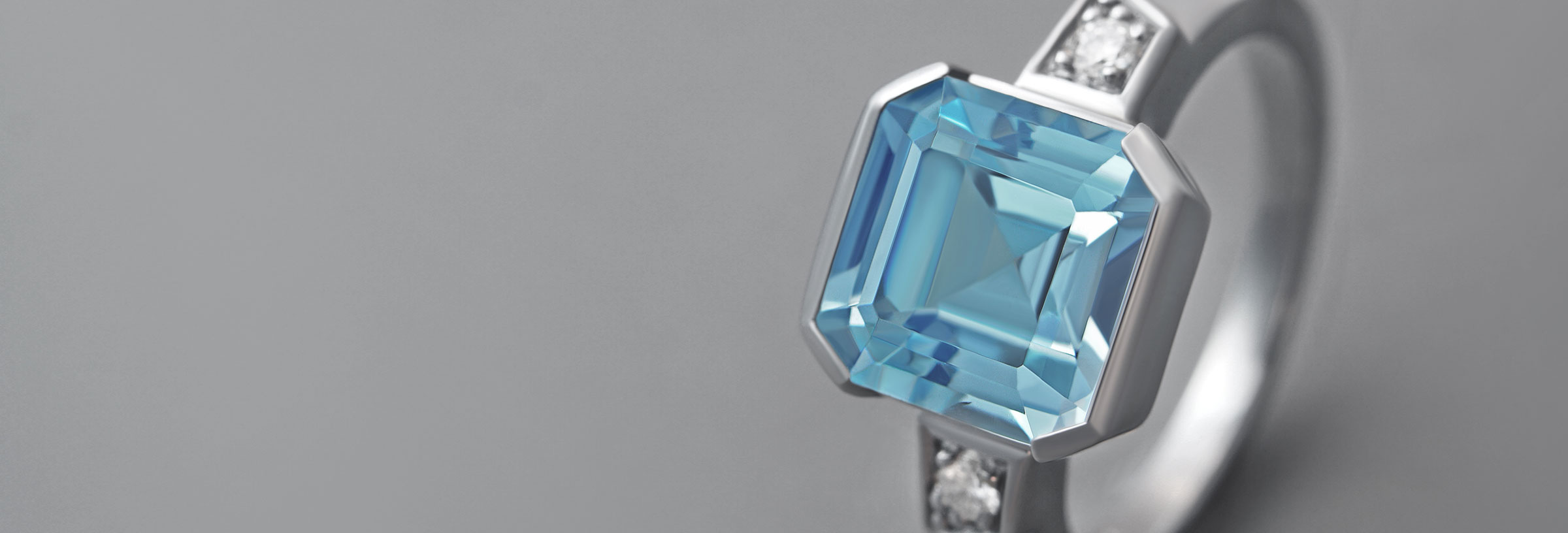 Swiss blue topaz, diamond and palladium art deco style engagement ring