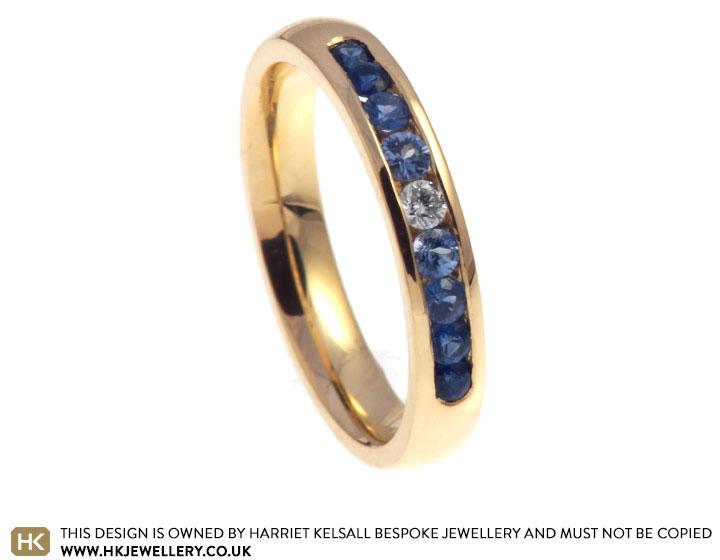 graduating-024ct-sapphire-and-diamond-9ct-yellow-gold-eternity-ring-11051_2.jpg