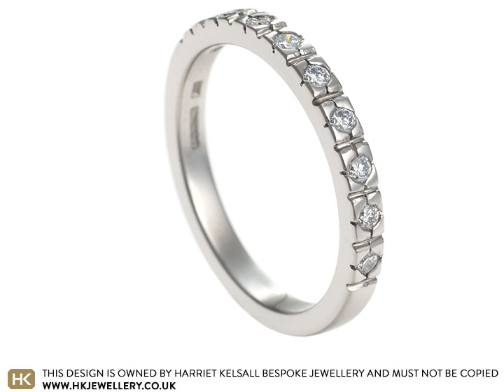 delicate-032ct-diamond-and-18ct-white-gold-half-eternity-ring-11563_2.jpg