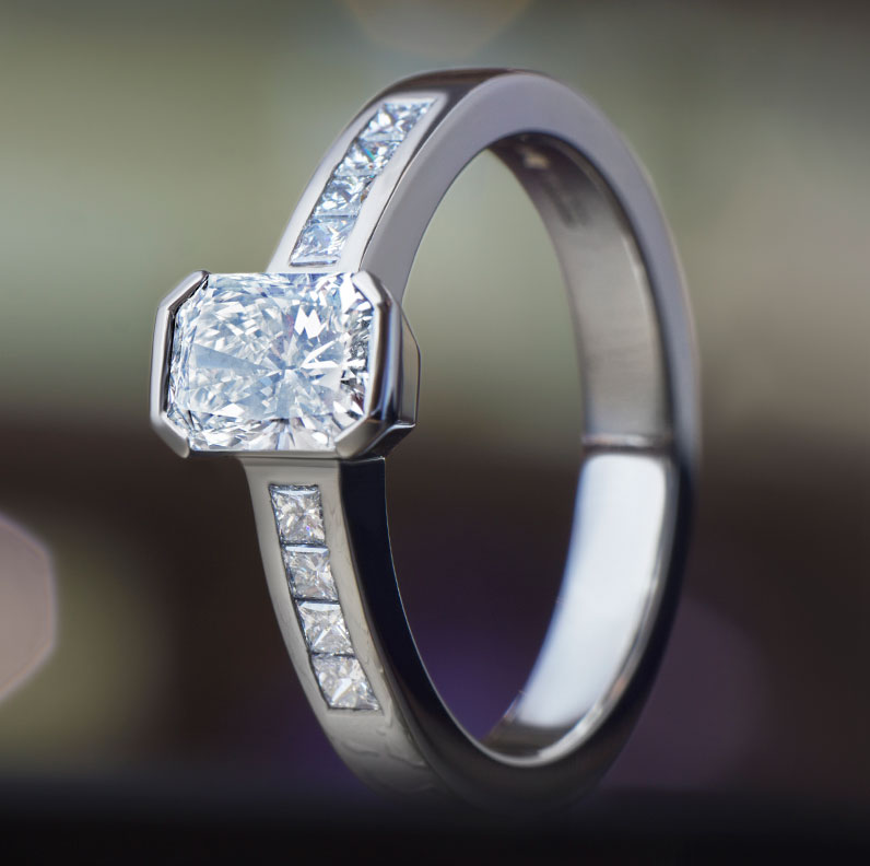 11960-Platinum-engagement-ring-with-radiant-and-princess-cut-diamonds-totalling-0.99ct_9.jpg