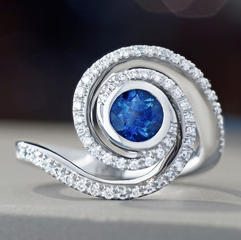 12001-Milky-way-inspired-platinum-engagement-ring-with-a-0.70ct-sapphire-and-59-G-VS-diamonds-totalling-0.50cts_9.jpg