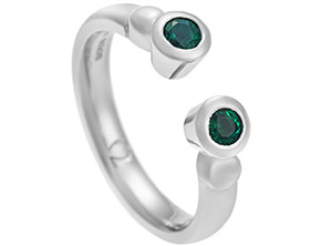 platinum-ring-with-two-brilliant-cut-emeralds-12208_1.jpg