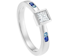 12564-platinum-engagement-ring-holding-princess-cut-diamond_1.jpg