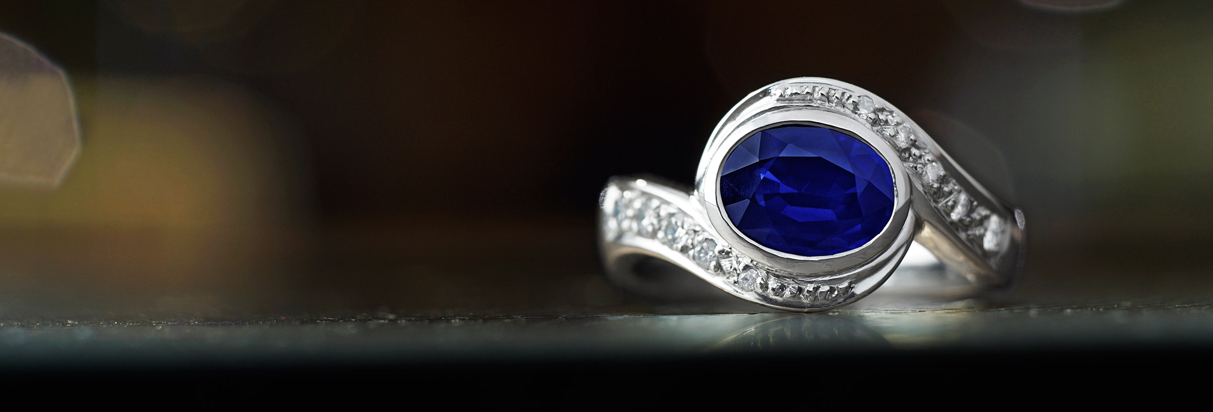 Twist style 1.44ct sapphire and pave set diamond ring