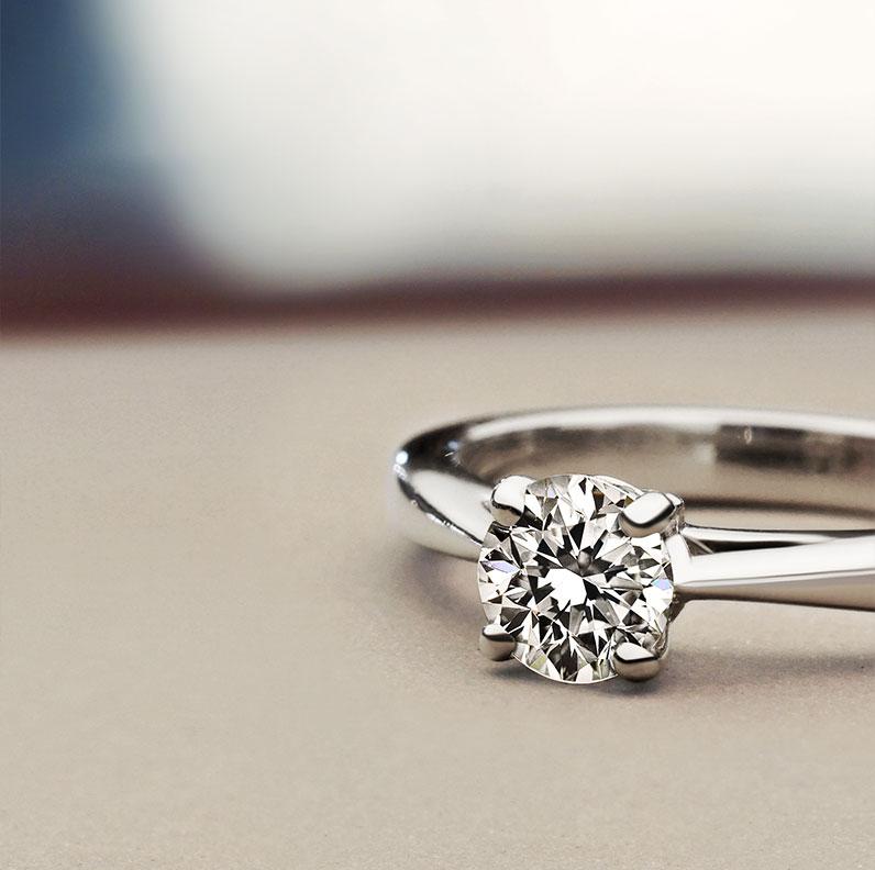 12689-solitaire-0.6ct-diamond-platinum-engagmenet-ring_9.jpg