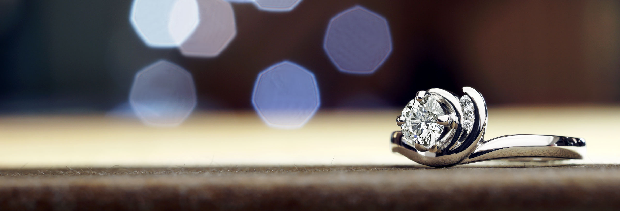 Wave inspired 0.53ct diamond and palladium engagement ring