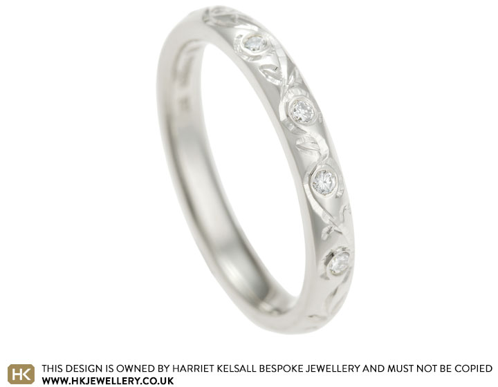 fairtrade-9ct-white-gold-diamond-and-floral-eternity-ring-13264_2.jpg