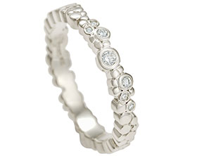 aboriginal-inspired-fairtrade-9-carat-white-gold-and-diamond-eternity-ring-13413_1.jpg