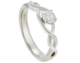 celtic-inspired-fairtrade-18-carat-white-gold-and-030ct-diamond-engagement-ring-13447_1.jpg