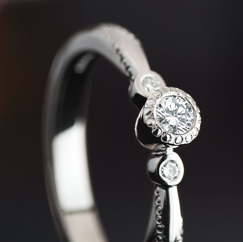 13477-palladium-and-diamond-engagement-ring-with-millgrain-detail_9.jpg