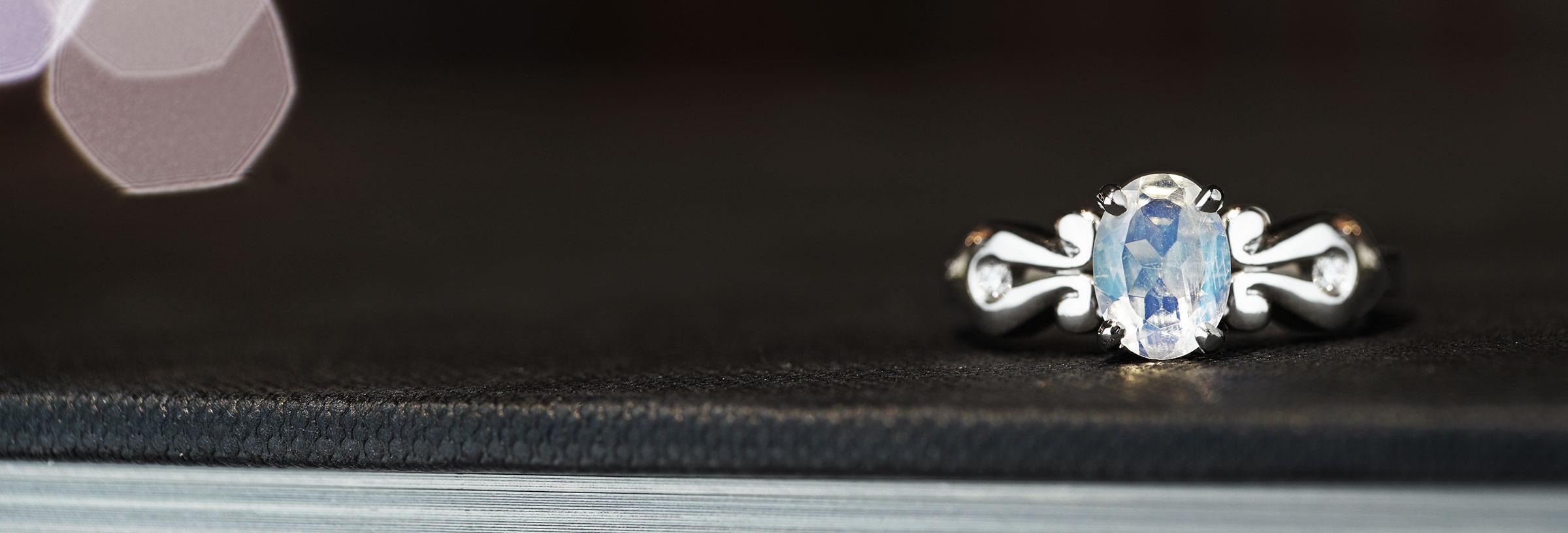 Victorian inspired palladium, moonstone and diamond engagement ring
