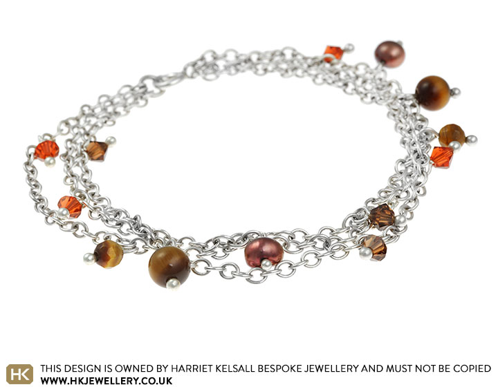 brown-and-russet-coloured-triple-chain-charm-bracelet-311_2.jpg
