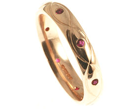 9ct-rose-gold-and-ruby-eternity-ring-with-celtic-engraving-2839_1.jpg