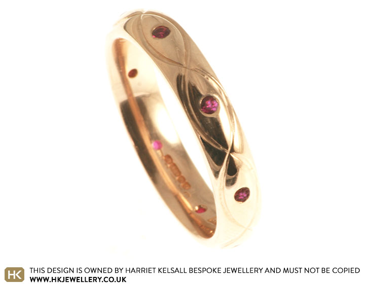 9ct-rose-gold-and-ruby-eternity-ring-with-celtic-engraving-2839_2.jpg