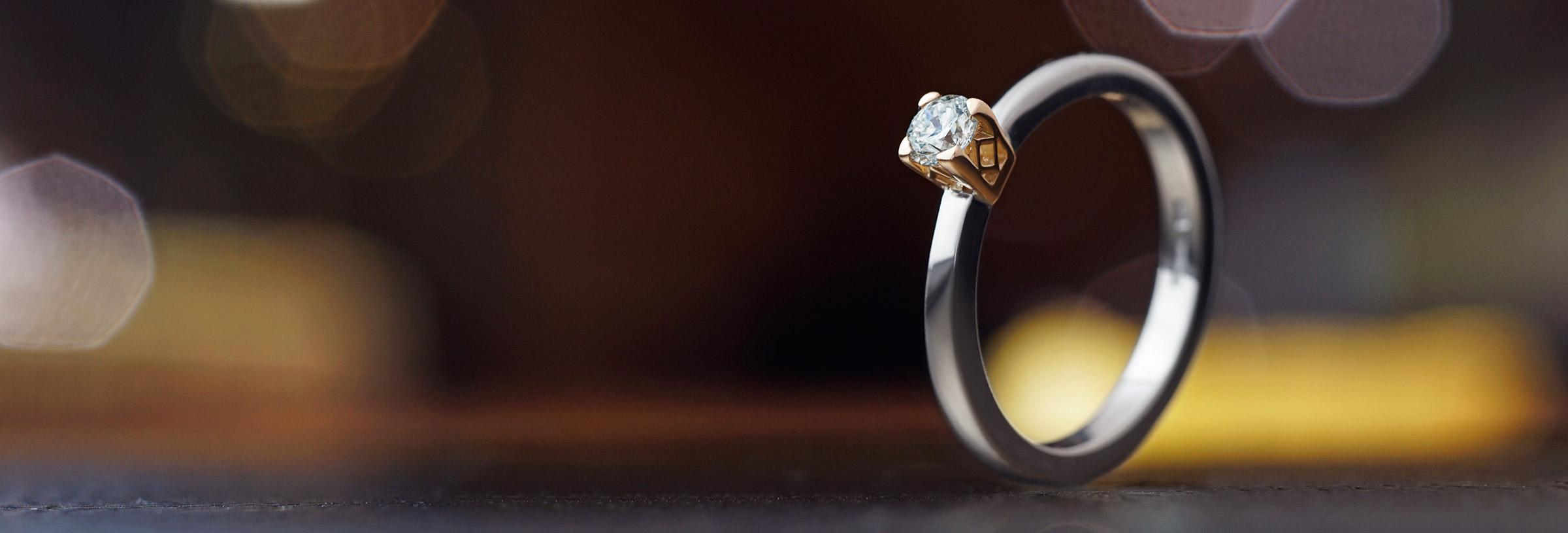 Art deco style 18ct rose and white gold diamond solitaire