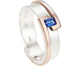 12712-Bespoke-9ct-white-gold-and-rose-gold-wedding-ring-holding-a-baguette-dark-blue-sapphire_1.jpg